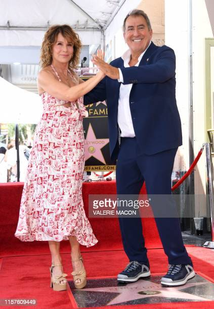 US actress Jennifer Grey dances with director chorerapher and producer Kenny Ortega during the ceremony honoring him with a star on The Hollywood...