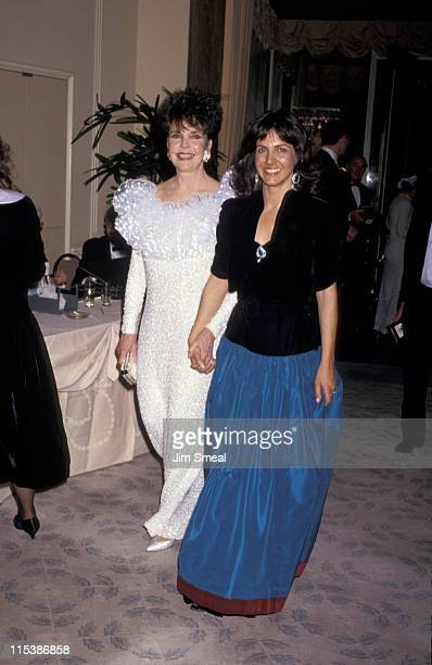Actress Jennifer Jones and guest during 59th Annual Academy Awards at Shrine Auditorium in Los Angeles California United States