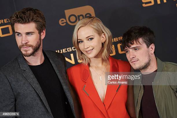 Actress Jennifer Lawrence actor Josh Hutcherson and actor Liam Hemsworth attend The Hunger Games Mockingjay Part 2 photocall at the Villamagna Hotel...