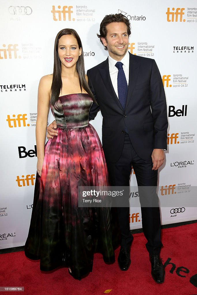 Actress Jennifer Lawrence (L) and Actor Bradley Cooper attend the 'Silver Linings Playbook' premiere during the 2012 Toronto International Film Festiva at Roy Thomson Halll on September 8, 2012 in Toronto, Canada.
