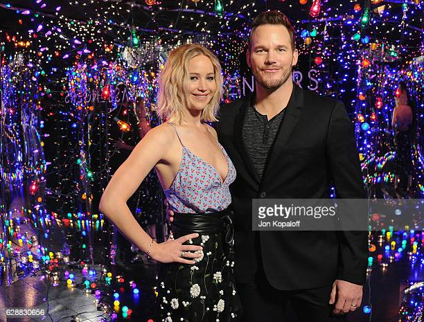 """Actress Jennifer Lawrence and actor Chris Pratt pose at the photo call for Columbia Pictures' """"Passengers"""" at the Four Seasons Hotel Los Angeles at..."""