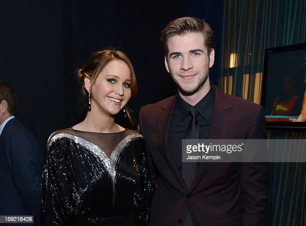 Actress Jennifer Lawrence and actor Liam Hemsworth pose backstage at the 39th Annual People's Choice Awards at Nokia Theatre LA Live on January 9...