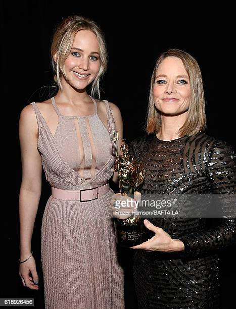 Actress Jennifer Lawrence and honoree Jodie Foster, recipient of the Stanley Kubrick Britannia Award for Excellence in Film, attend the 2016 AMD...