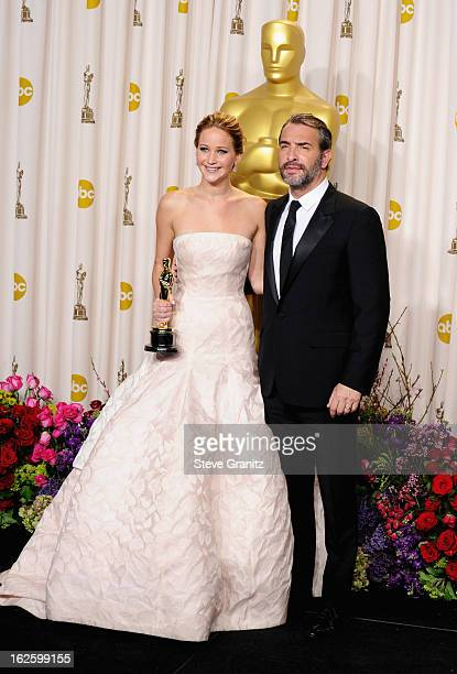 Actress Jennifer Lawrence and presenter Jean Dujardin pose in the press room during the Oscars at the Loews Hollywood Hotel on February 24, 2013 in...