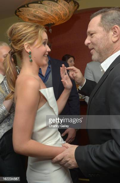 Actress Jennifer Lawrence and producer Harvey Weinstein attend the Vanity Fair Barneys New York and The Weinstein Company celebration of Silver...