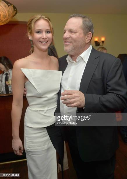 Actress Jennifer Lawrence and producer Harvey Weinstein attend the Vanity Fair Barneys New York and The Weinstein Company celebration of 'Silver...