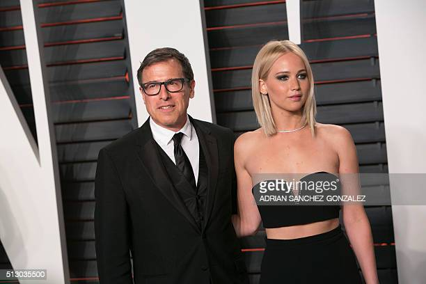 US actress Jennifer Lawrence and US director David O Russell pose as they arrive to the 2016 Vanity Fair Oscar Party in Beverly Hills California on...