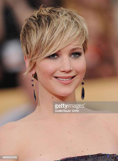 Actress Jennifer Lawrence arrives at the 20th Annual Screen Actors Guild Awards at The Shrine Auditorium on January 18 2014 in Los Angeles California