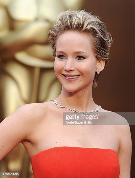 Actress Jennifer Lawrence arrives at the 86th Annual Academy Awards at Hollywood Highland Center on March 2 2014 in Hollywood California