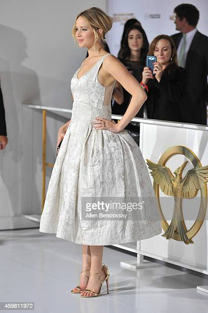 Actress Jennifer Lawrence arrives at the Los Angeles premiere of 'The Hunger Games Mockingjay Part 1' at Nokia Theatre LA Live on November 17 2014 in...
