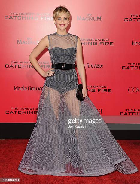Actress Jennifer Lawrence arrives at the Los Angeles Premiere 'The Hunger Games Catching Fire' at Nokia Theatre LA Live on November 18 2013 in Los...