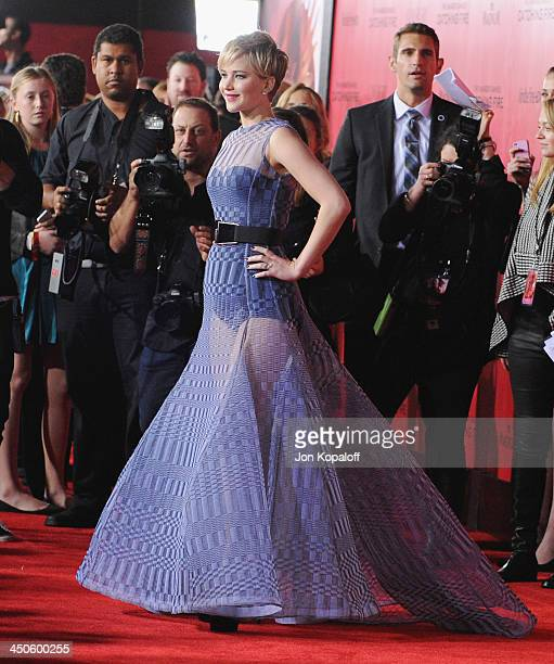 Actress Jennifer Lawrence arrives at the Los Angeles Premiere The Hunger Games Catching Fire at Nokia Theatre LA Live on November 18 2013 in Los...