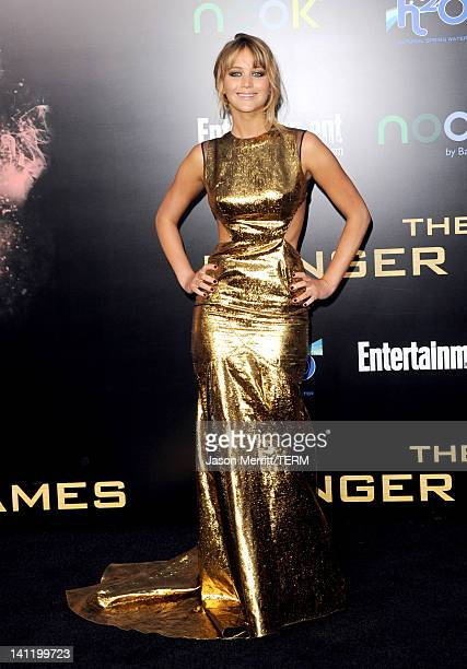 Actress Jennifer Lawrence arrives at the premiere of Lionsgate's The Hunger Games at Nokia Theatre LA Live on March 12 2012 in Los Angeles California