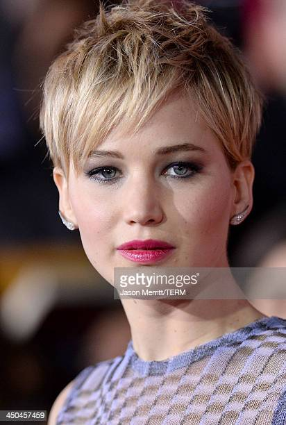 Actress Jennifer Lawrence arrives at the premiere of Lionsgate's The Hunger Games Catching Fire at Nokia Theatre LA Live on November 18 2013 in Los...