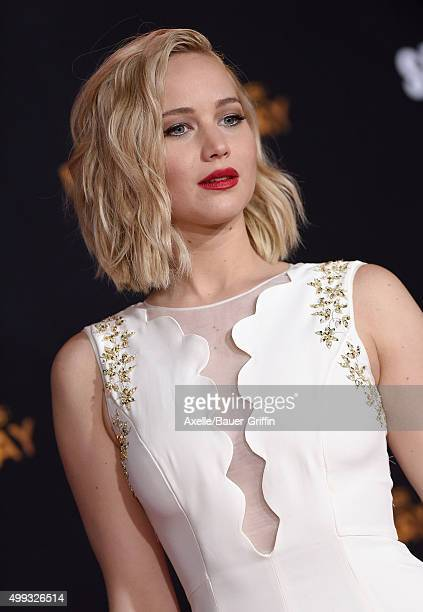 The hunger games mockingjay part 1 film actress jennifer lawrence arrives at the premiere of lionsgates the hunger games mockingjay part 2 voltagebd Image collections