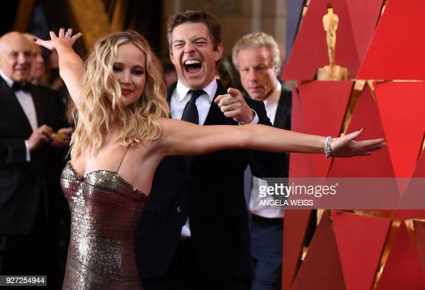 TOPSHOT US actress Jennifer Lawrence arrives for the 90th Annual Academy Awards on March 4 in Hollywood California / AFP PHOTO / ANGELA WEISS