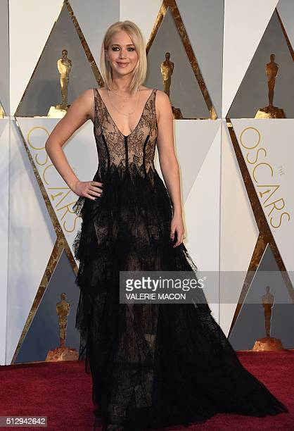 Actress Jennifer Lawrence arrives on the red carpet for the 88th Oscars on February 28 2016 in Hollywood California AFP PHOTO / VALERIE MACON / AFP /...