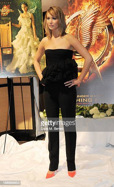 Actress Jennifer Lawrence attends The Hunger Games Catching Fire photocall at the 2013 Cannes Film Festival at Majestic Barierre on May 18 2013 in...