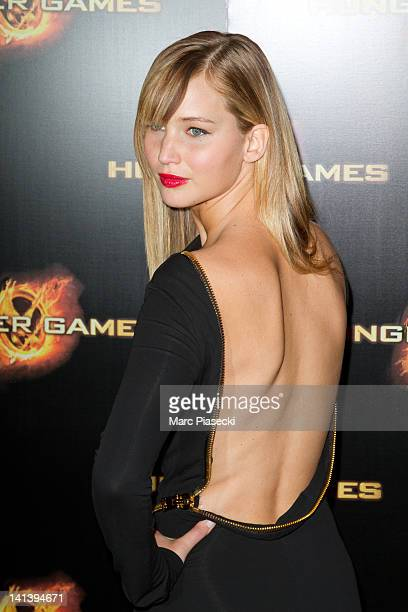 "Actress Jennifer Lawrence attends the ""Hunger Games"" Paris Premiere photocall at Cinema Gaumont Marignan on March 15, 2012 in Paris, France."