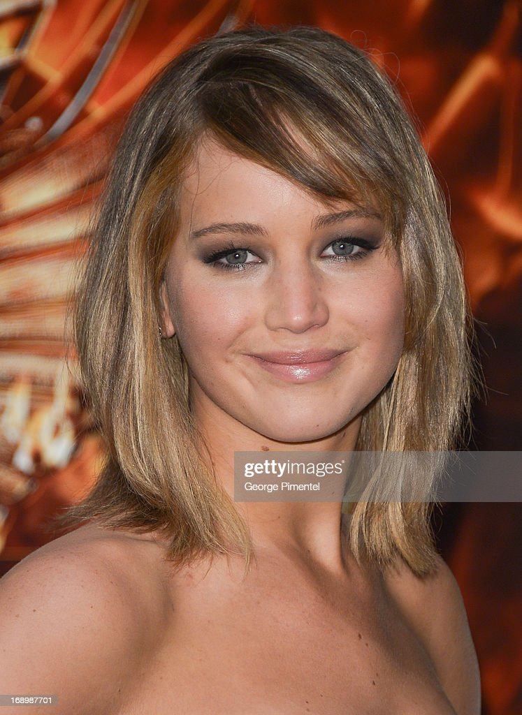 Actress Jennifer Lawrence attends the photocall for 'The Hunger Games: Catching Fire' at The 66th Annual Cannes Film Festival at Majestic Hotel on May 18, 2013 in Cannes, France.