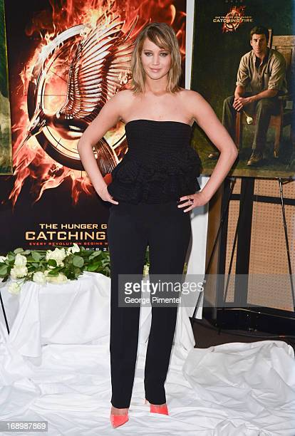 Actress Jennifer Lawrence attends the photocall for 'The Hunger Games Catching Fire' at The 66th Annual Cannes Film Festival at Majestic Hotel on May...