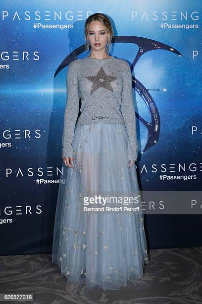 """Actress Jennifer Lawrence, dressed in Dior, attends the """"Passengers"""" Paris Photocall at Hotel George V on November 29, 2016 in Paris, France."""