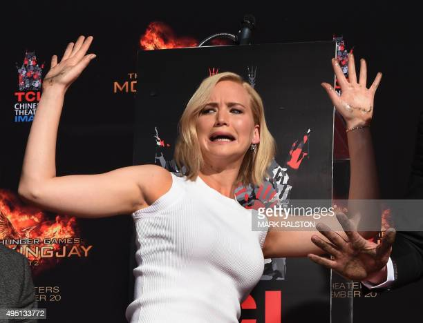 """Actress Jennifer Lawrence gestures during Lionsgate's Lionsgate's """"The Hunger Games: Mockingjay - Part 2"""" Hand and Footprint Ceremony at TCL Chinese..."""