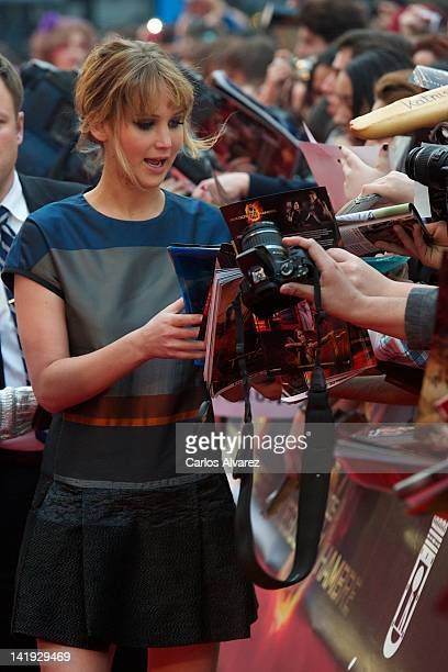 Actress Jennifer Lawrence of The Hunger Games attends an event with fans at Capitol cinema on March 26 2012 in Madrid Spain