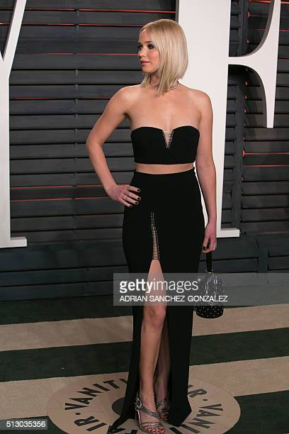 US actress Jennifer Lawrence poses as she arrives to the 2016 Vanity Fair Oscar Party in Beverly Hills California on February 28 2016 / AFP / ADRIAN...