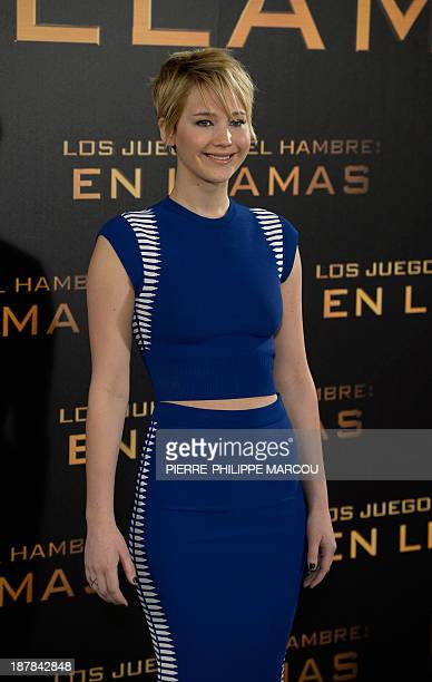 US actress Jennifer Lawrence poses for photographers during the photocall of the film The Hunger Games Catching Fire in Madrid on November 13 2013...