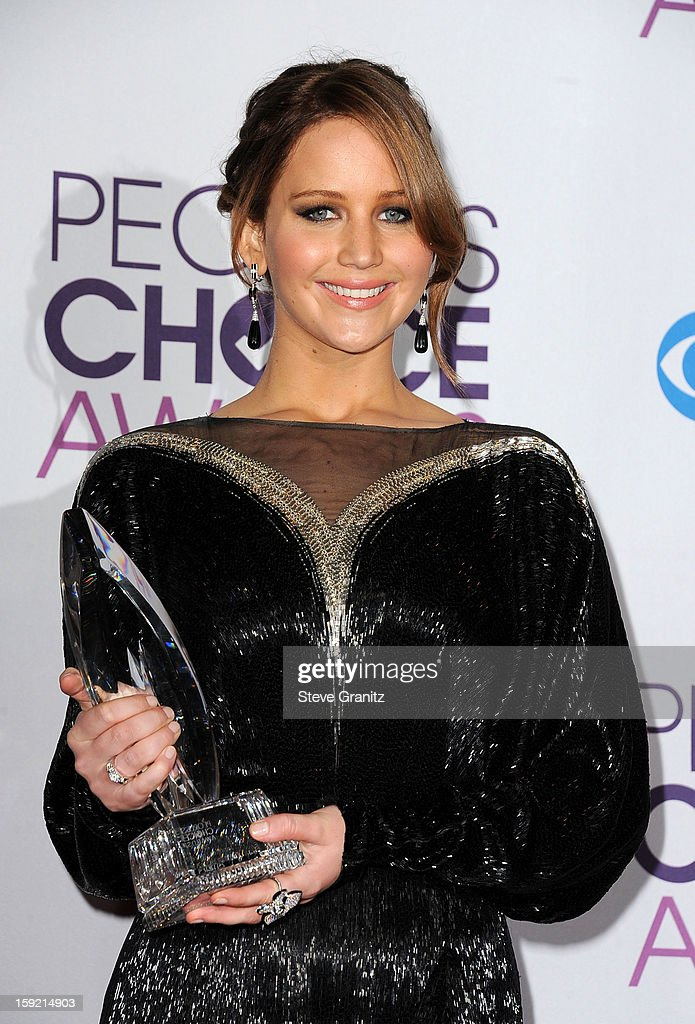 Actress Jennifer Lawrence poses in the press room during the 2013 People's Choice Awards at Nokia Theatre L.A. Live on January 9, 2013 in Los Angeles, California.