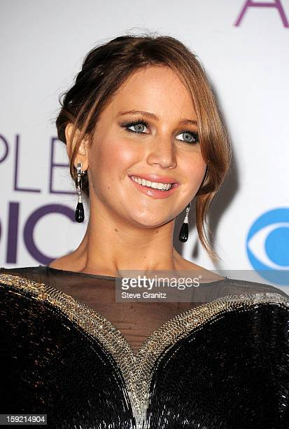 Actress Jennifer Lawrence poses in the press room during the 2013 People's Choice Awards at Nokia Theatre L.A. Live on January 9, 2013 in Los...