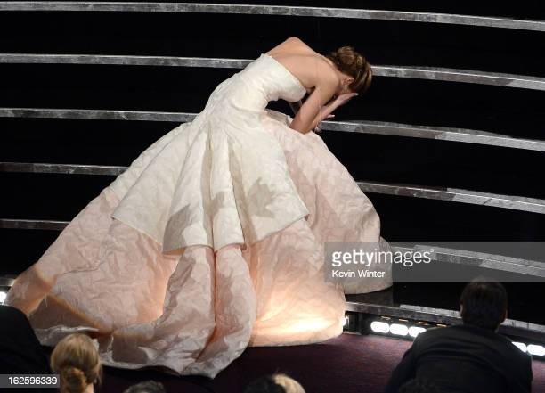 Actress Jennifer Lawrence reacts after winning the Best Actress award for Silver Linings Playbook during the Oscars held at the Dolby Theatre on...