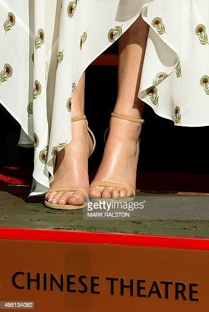 Actress Jennifer Lawrence stands in cement during The Hunger Games Mockingjay Part 2 Hand and Footprint Ceremony at TCL Chinese Theatre in Hollywood...