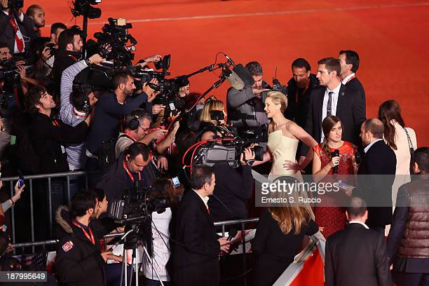 Actress Jennifer Lawrence talks to reporters as she attends the 'The Hunger Games Catching Fire' Premiere during The 8th Rome Film Festival at...