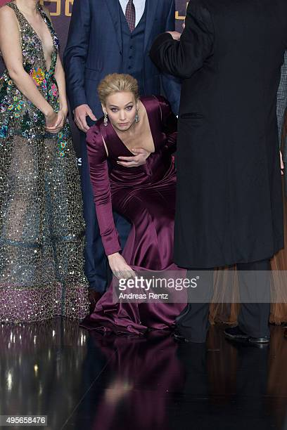 Actress Jennifer Lawrence wearing a Dior dress attends the world premiere of the film 'The Hunger Games Mockingjay Part 2' at CineStar on November 4...
