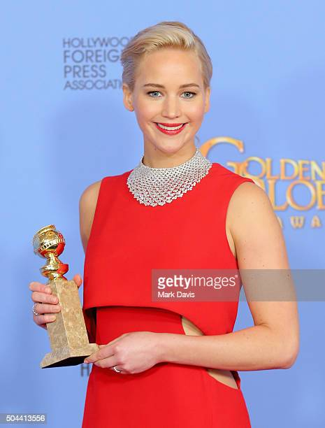 Actress Jennifer Lawrence winner of Best Performance by an Actress in a Motion Picture Musical or Comedy for 'Joy' poses in the press room during the...