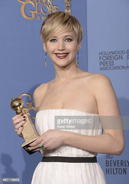 Actress Jennifer Lawrence winner of Best Supporting Performance in a Motion Picture – Drama Musical or Comedy for 'American Hustle' poses in the...