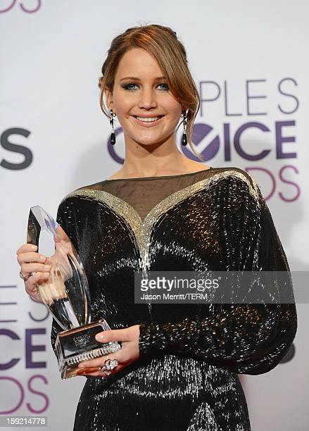 Actress Jennifer Lawrence winner of Favorite Movie Actress poses in the press room at the 39th Annual People's Choice Awards at Nokia Theatre LA Live...