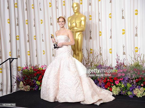 Actress Jennifer Lawrence winner of the Best Actress award for Silver Linings Playbook poses in the press room during the Oscars held at Loews...