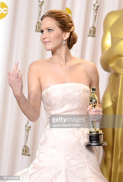 "Actress Jennifer Lawrence, winner of the Best Actress award for ""Silver Linings Playbook,"" poses in the press room during the Oscars held at Loews..."