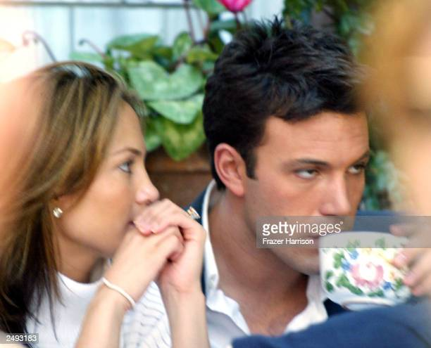 Actress Jennifer Lopez and fiance actor Ben Affleck dine at the Ivy Restaurant on March 28 2003 in Beverly Hills California Lopez and Affleck...