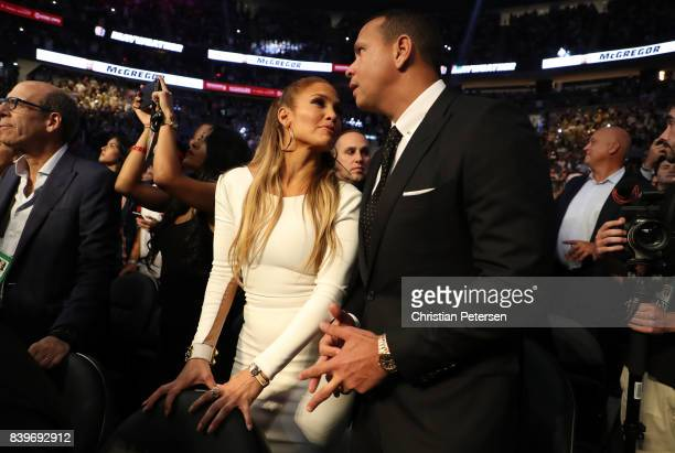 Actress Jennifer Lopez and former MLB player Alex Rodriguez attend the super welterweight boxing match between Floyd Mayweather Jr and Conor McGregor...