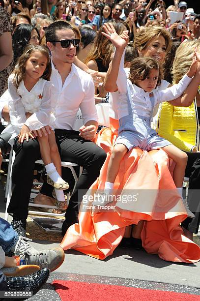 Actress Jennifer Lopez and her children Max and Emme pose with Casper Smart at the ceremony that honored her with a Star on The Hollywood Walk of Fame