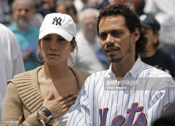 Actress Jennifer Lopez and husband Marc Anthony attend a subway series game between the New York Mets and the New York Yankees at Shea Stadium in...