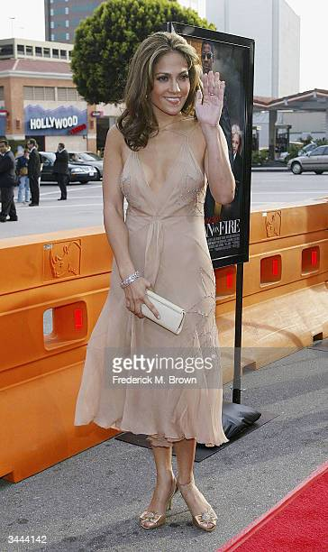 Actress Jennifer Lopez attends the film premiere of Man on Fire at the Mann National Theater on April 18 2004 in Westwood California