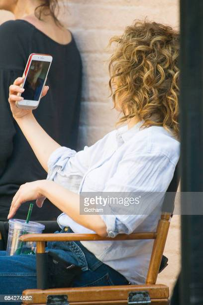 Actress Jennifer Lopez is seen on a video call with Alex Rodriguez while filming 'Shades of Blue' in Queens on May 17 2017 in New York City