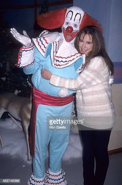 Actress Jennifer Love Hewitt and Bozo The Clown attend the 65th Annual Hollywood Christmas Parade on December 1 1996 at KTLA Studios in Hollywood...
