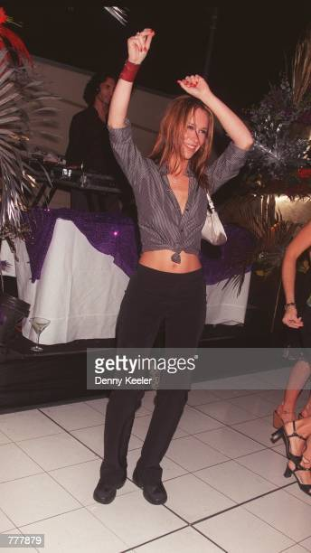 Actress Jennifer Love Hewitt dances at a party for the debut of Reebok Classic Marathon Race shoe August 24 2000 in Beverly Hills CA