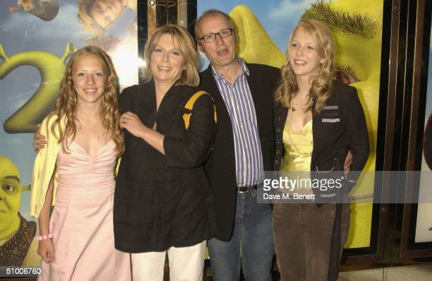 Actress Jennifer Saunders with husband Ade Edmondson and daughters Freya and Beatrice arrive at the UK Charity Premiere of 'Shrek 2' at the Empire...